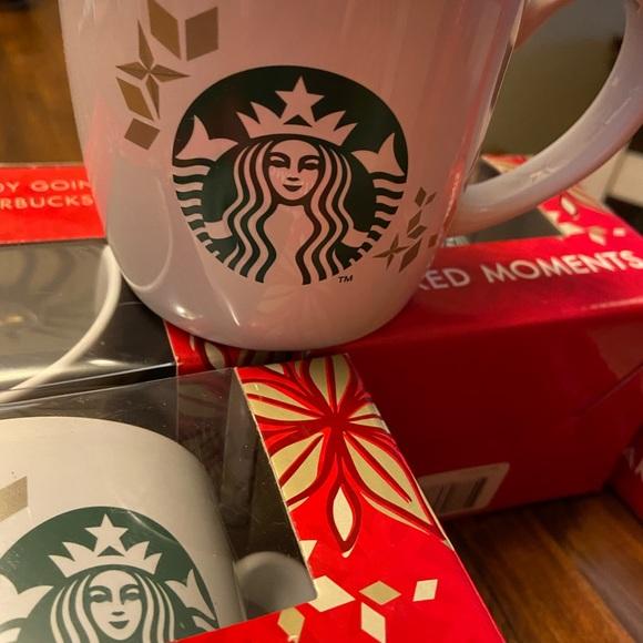 Set of four Starbucks cups